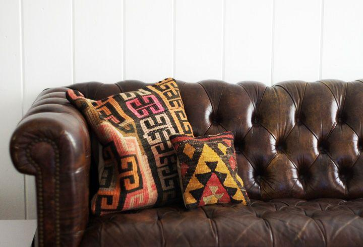 brown leather chesterfield sofa + ikat pillows | Pillows, Brown leather  chesterfield sofa, Leather chesterfield