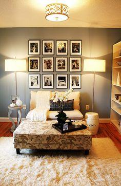 love the collection of photos behind the chair-would look great above our new couch!! @the handmade home