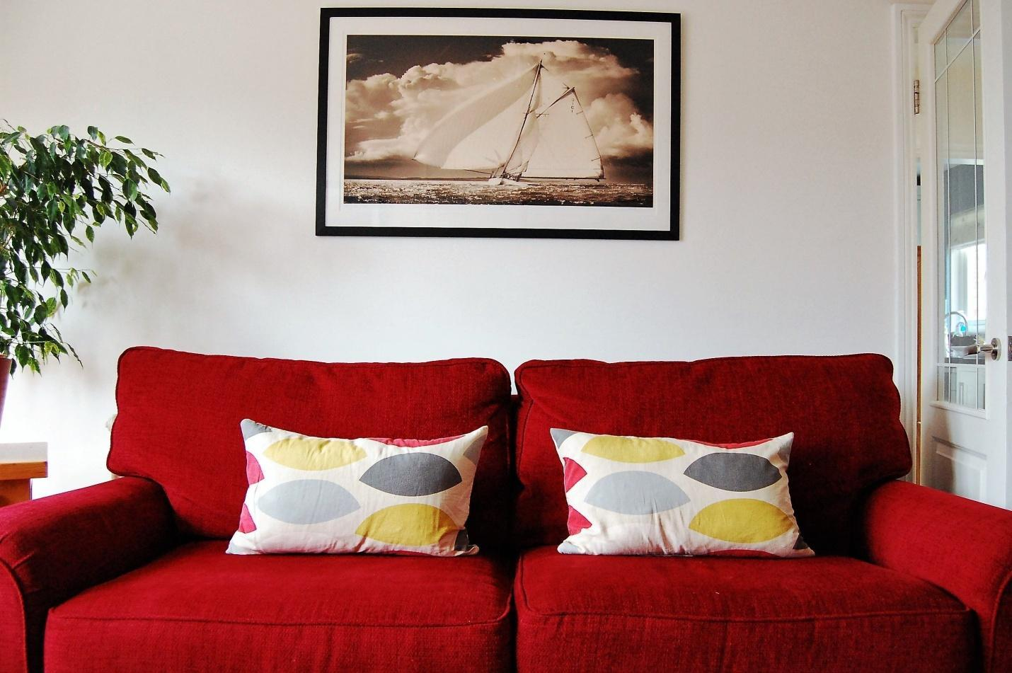 red sofa with grey and yellow cushion | Red couch decor, Red couch living  room, Red sofa
