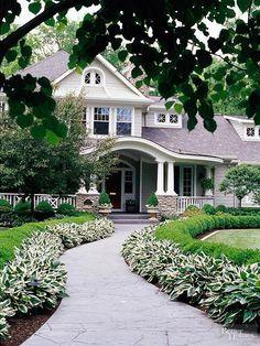 Transform your front walk into a stylish statement by edging it in easy-care plants such as variegated hosta and boxwood. Conjure even more magic by putting a gentle curve in the path; it will offer your walkway with a soft, gentle look. Test Garden Tip: Choose an interesting material to make the trip to your front door even more memorable. Bricks, flagstone, and pavers all lend more charm than traditional cement.