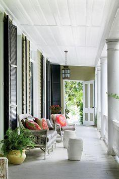 Wicker Front Porch | Use these decorating ideas to update your outdoor spaces with bright beach colors and relaxing coastal accents.